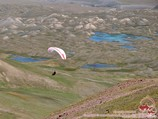 Paragliding near the base camp (3600 m). Lenin peak, Pamir, Kyrgyzstan