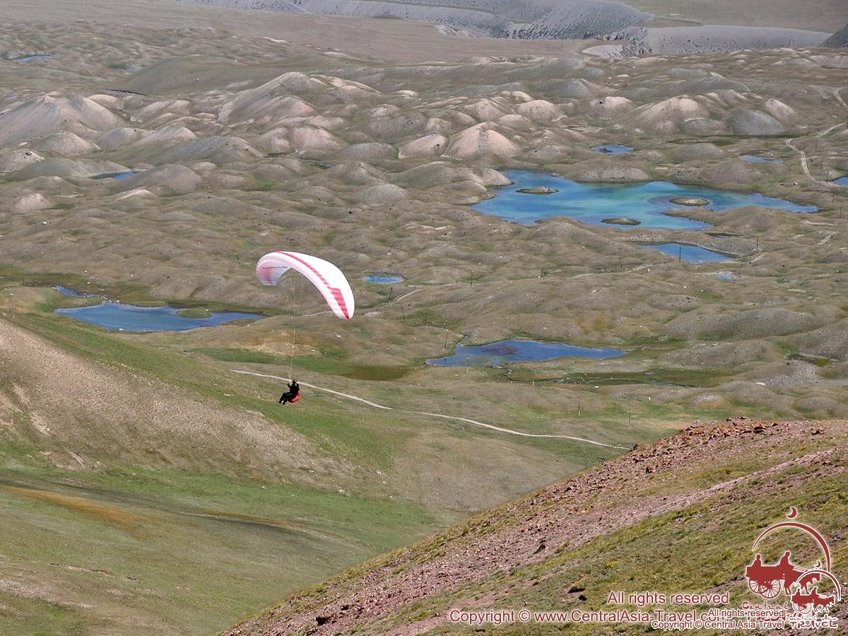 Paragliding near the base camp (3600 m). Lenin peak, Pamir, Kyrgyzstan