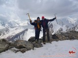 The summit of the Petrovsky peak (4830m). Lenin peak, Pamir, Kyrgyzstan