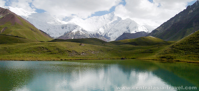 Walk on the lakes near the base camp. Lenin peak, Pamir, Kyrgyzstan