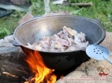 Dinner cooked on the campfire. Trekking to lake Sary-Chelek. Kyrgyzstan