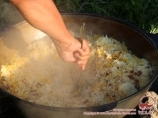 Pilaf. Dinner cooked on the campfire. Trekking to lake Sary-Chelek. Kyrgyzstan