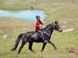 Local resident on horseback. Pamir Mountains, Kyrgyzstan
