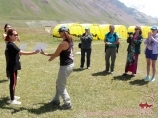 Presentation of commemorative certificates. Base camp at the foot of Lenin peak. Pamir Mountains