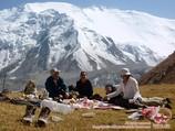 Picnic on Travelers Pass (4150 m). Lenin peak, Pamir, Kyrgyzstan