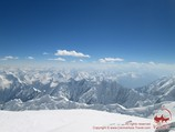 View from the summit of Lenin Peak (7134 m). Pamir, Kyrgyzstan