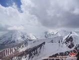 View from Petrovsky peak (4830m). Lenin peak, Pamir, Kyrgyzstan