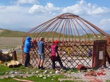 Setting yurt at the base camp (3600 m). Lenin peak, Pamir, Kyrgyzstan
