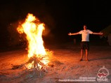 Evening campfire in the yurt camp. Kyzylkum desert, Uzbekistan. Tour To Aydarkul Lake via Kyzyl-Kum desert