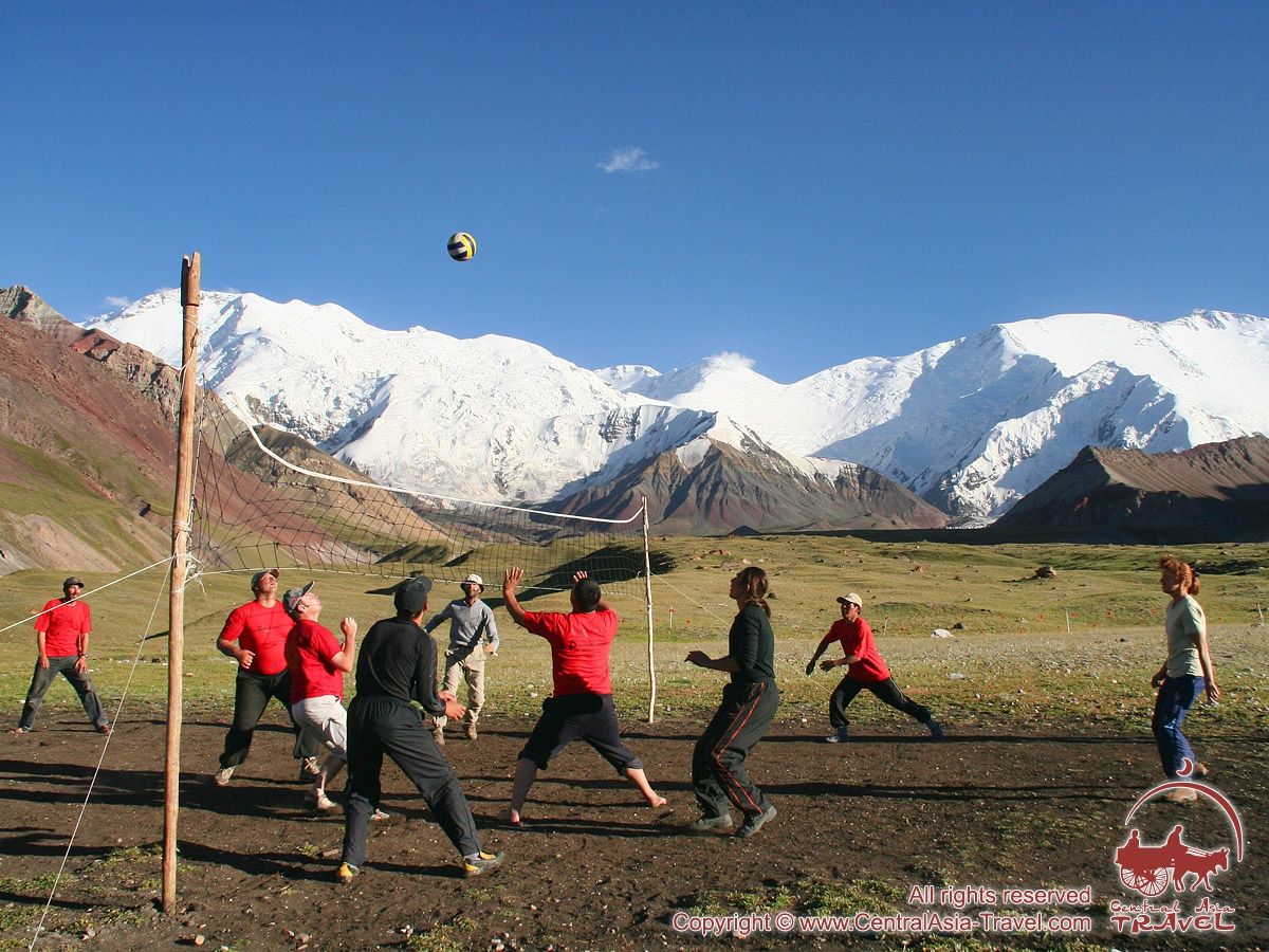 Volleyball at the base camp. Lenin peak, Pamir, Kyrgyzstan