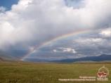 Rainbow over the Lukovaya meadow. Pamir, Kyrgyzstan