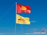 Kyrgyz flag and Central Asia Travel. Base camp at the peak of Lenin