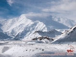 View on Lenin Peak and Travelers Pass. Pamir, Kyrgyzstan