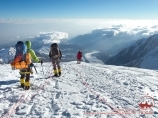 The descent from the Razdelnaya Peak (6148 m). Lenin peak, Pamir, Kyrgyzstan
