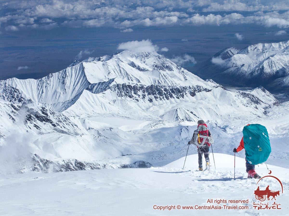 The descent from the Razdelnaya Peak (6148 m). Lenin peak, Pamir, Kyrgyzstan
