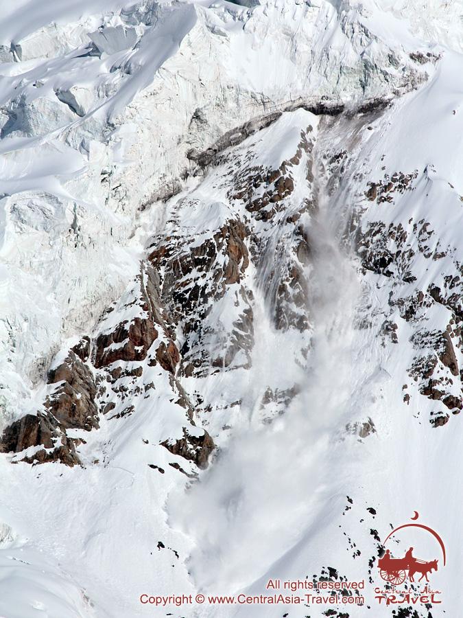 Avalanche. Lenin peak, Pamir, Kyrgyzstan